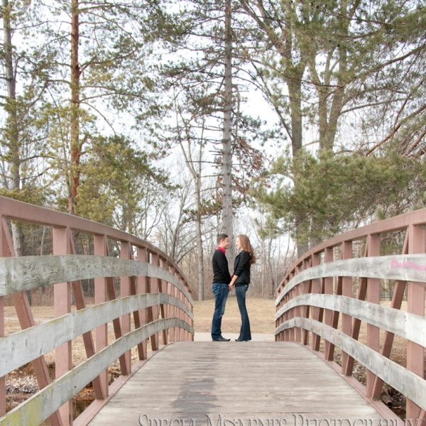 Shannon & Jordan's winter engagement photos in Downtown Milford